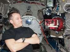 Flight Engineer Tom Marshburn with<br /> SPHERES-VERTIGO investigation<br /> hardware.<br /> Credit: NASA
